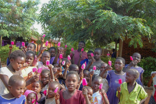 children at the orphanage eating popsicles