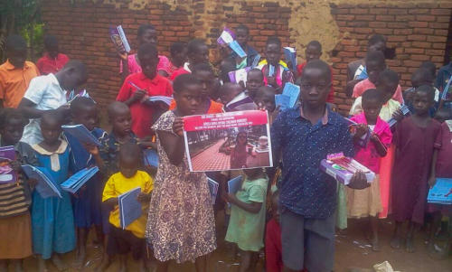 children thank a donor for helping buy food